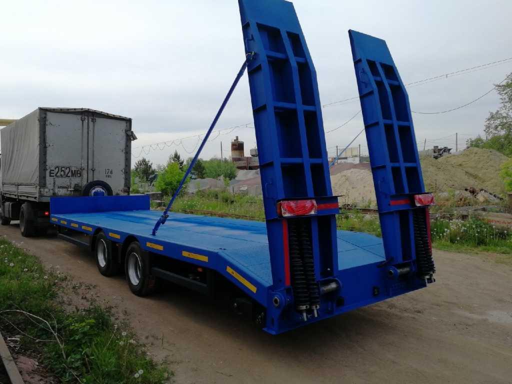 Низкорамный прицеп для перевозки спец техники до 9 тонн в Москве. Фото 3
